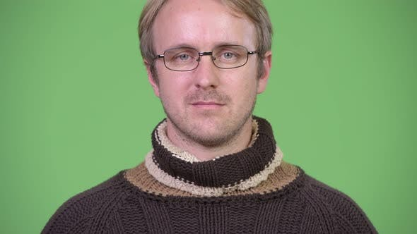 Thumbnail for Blonde Handsome Man Wearing Turtleneck Sweater and Eyeglasses
