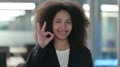 Portrait of Positive African Businesswoman Showing OK Sign