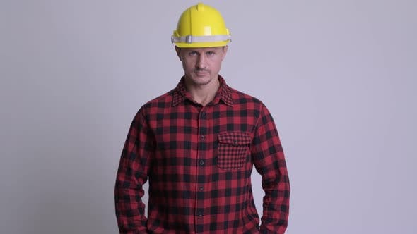 Cover Image for Handsome Bearded Man Construction Worker Against White Background