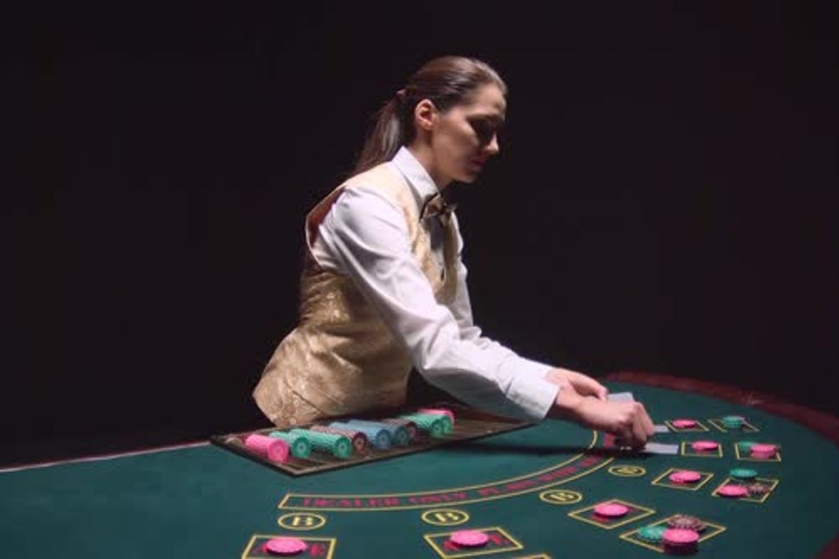 Casino Croupier Girl Distributes Cards on the Poker Table Top. Black  Background. Slow Motion by KinoMaster on Envato Elements