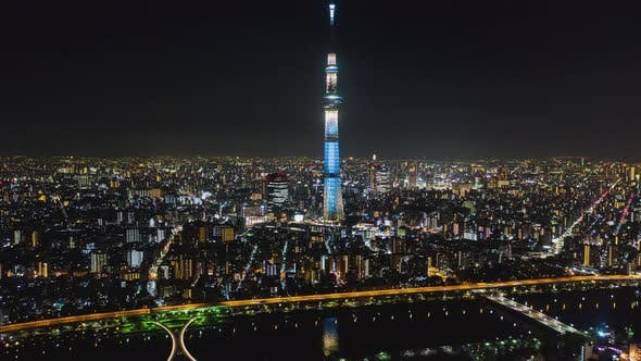 Thumbnail for Hyperlapse time-lapse aerial view of Tokyo Skytree and Japan cityscape at night