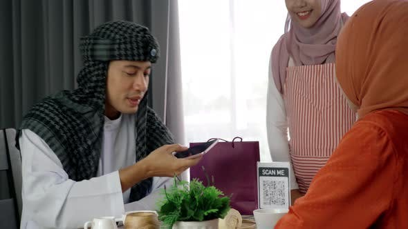 Thumbnail for Asian Muslim Man Using Mobile Phone To Scan QR Code 12