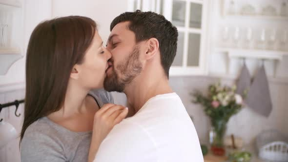 Thumbnail for Playful Couple Kissing in Kitchen