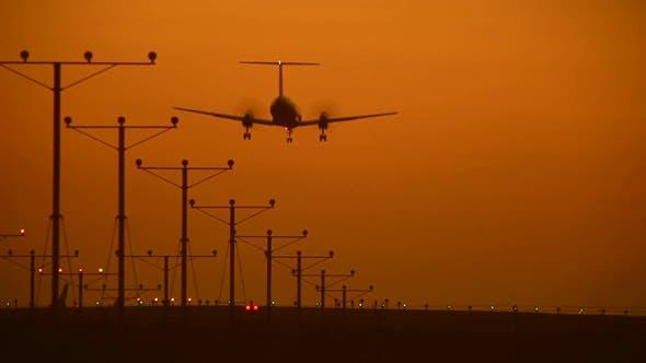 Thumbnail for large plane landing at sunset