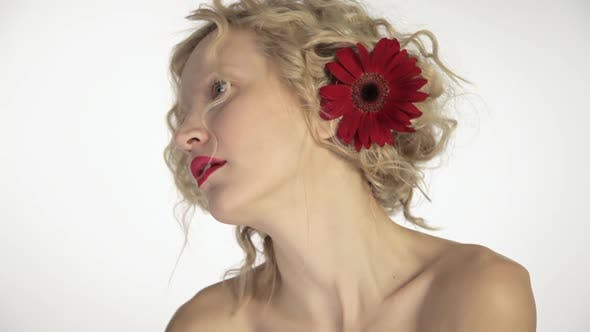 Thumbnail for Beautiful young woman with flower in her hair