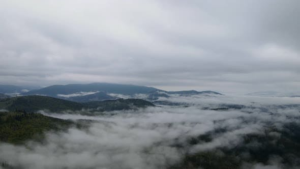 Cover Image for Mountain Fog Time Lapse. Carpathians. Ukraine. Aerial. Gray, Flat, No Color.