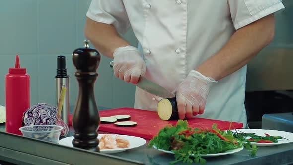 Thumbnail for Cook Cuts Eggplant for Salad.