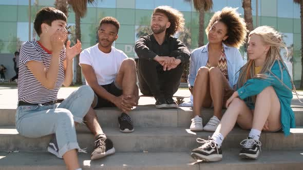 Cool Young Diverse Friends Chilling on Street