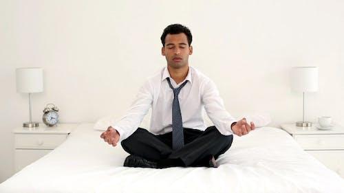 Calm Handsome Businessman Meditating