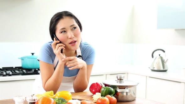 Thumbnail for Happy Woman Preparing Dinner