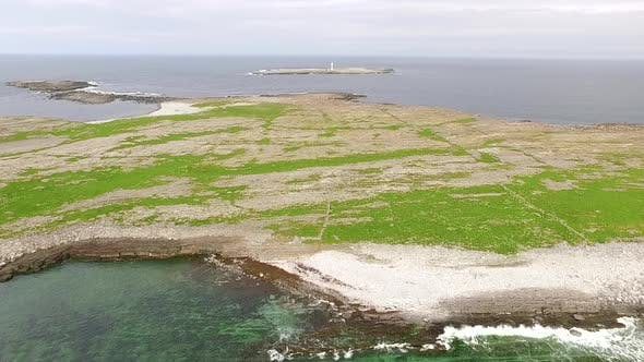 Thumbnail for Bird flight to the lighthouse in aran islands, Inishmore