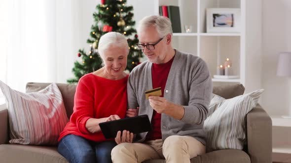 Thumbnail for Old Couple with Tablet and Bank Card on Christmas