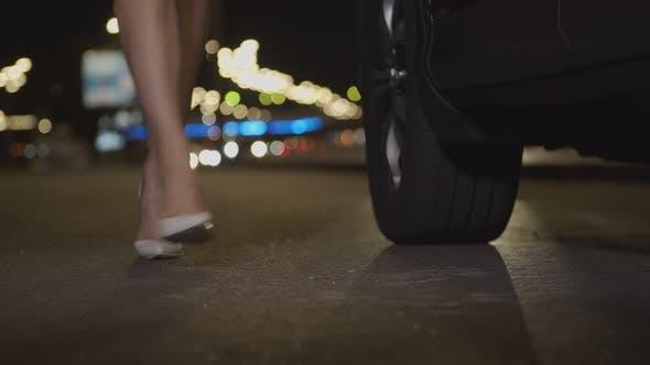 Thumbnail for Female Legs in High Heels Walk on Roadside at Dusk