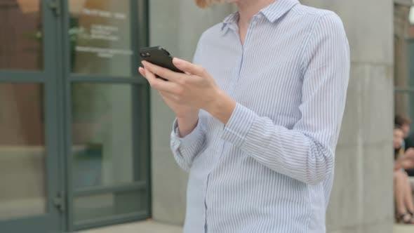 Walking Woman Using Smartphone Browsing Internet
