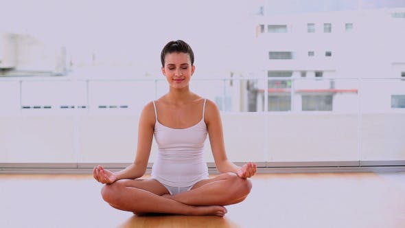Thumbnail for Calm Beautiful Woman Relaxing In Yoga Position