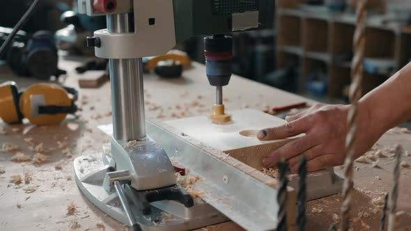 Thumbnail for Foreman Is Drilling a Hole in Wooden Plank at His Workstation, Craftman Man Work with Furniture Wood