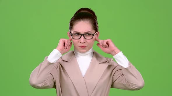 Thumbnail for Girl Closes Her Ears From a Sharp Noise. Green Screen