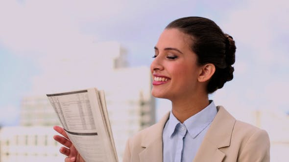 Thumbnail for Delighted Beautiful Businesswoman Reading News