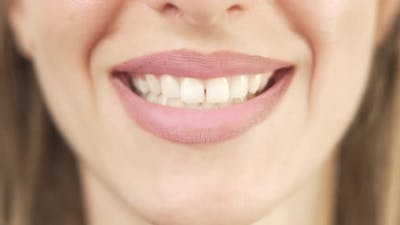 Close Up of Smiling Teeth Isolated