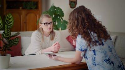 Two Businesswomen Conversation