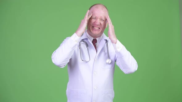 Thumbnail for Stressed Mature Bald Man Doctor Having Headache