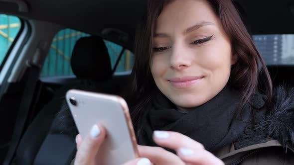 Thumbnail for Girl Browsing on Smartphone while Sitting in Car
