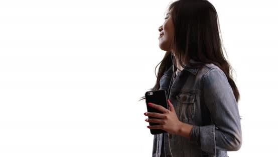 Thumbnail for Close up of happy millennial listening to music on cell phone isolated on white