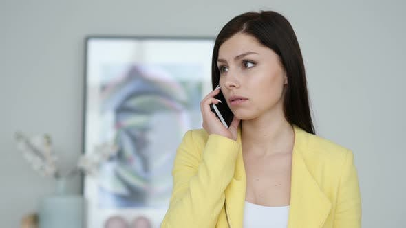 Cover Image for Tense Serious Woman Discussing, Talking on Smartphone