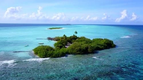 Wide angle birds eye travel shot of a paradise sunny white sand beach and blue ocean background