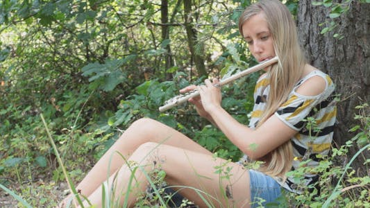 Thumbnail for Girl Playing The Flute