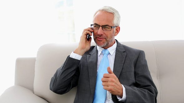Thumbnail for Businessman Talking On The Phone On The Couch