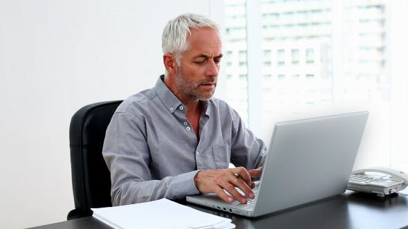 Thumbnail for Casual Businessman Working On Laptop At Desk