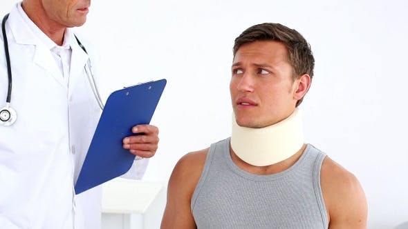 Thumbnail for Sportsman In Neck Brace Being Checked By Doctor