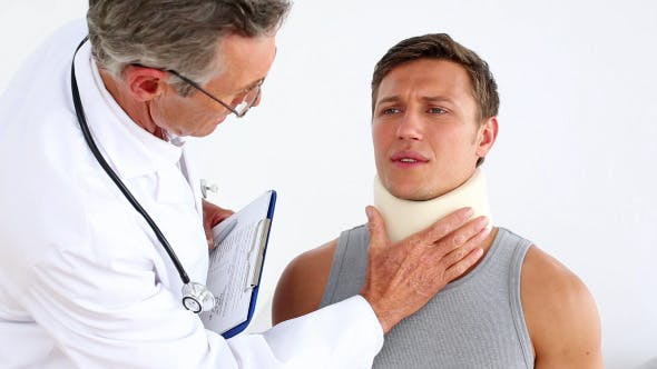 Thumbnail for Doctor Checking Sportsman In Neck Brace