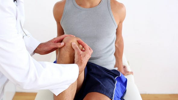 Thumbnail for Doctor Touching Sportsmans Injured Knee 2