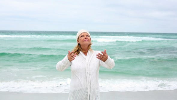 Thumbnail for Retired Woman Spreading Her Arms By The Sea