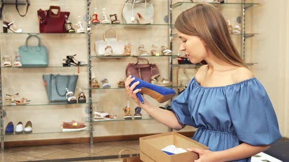 Thumbnail for Woman Looking at Her New Shoes and at Camera