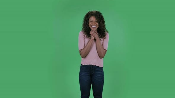 Thumbnail for Portrait of Beautiful African American Young Woman Smiles with Happy Joy. Burning Brunette with Wavy