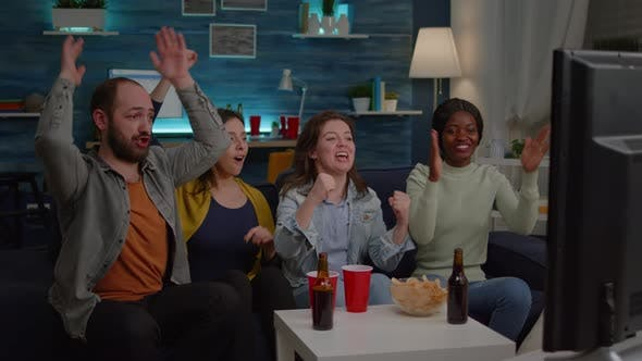 Multiracial Friends Celebrating Football Goal During Game Competition