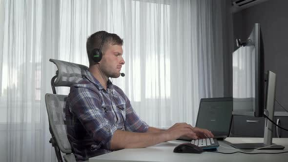 Thumbnail for Handsome Customer Support Operator Typing on a Computer