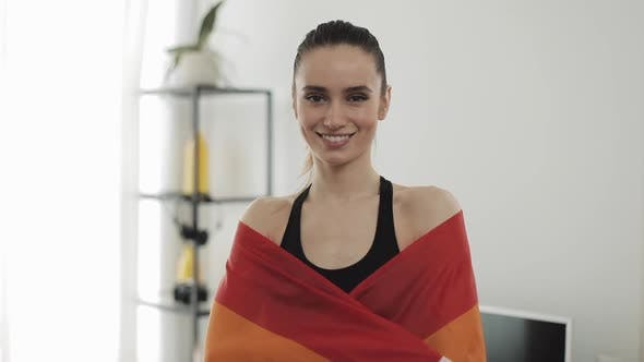 Thumbnail for Portrait Young Woman Wearing LGBT Flag Standing at Home. She Looking Into the Camera, Smiling.