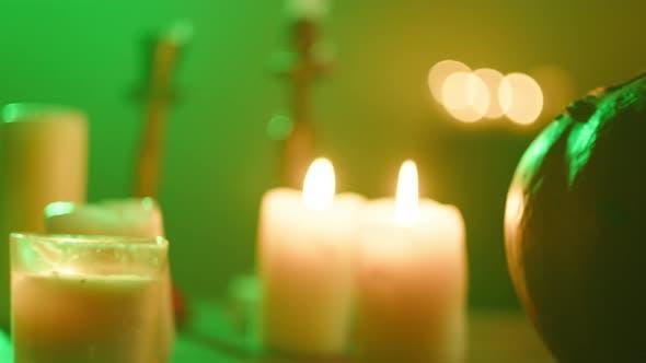 Jackolantern and Burning Candles Closeup