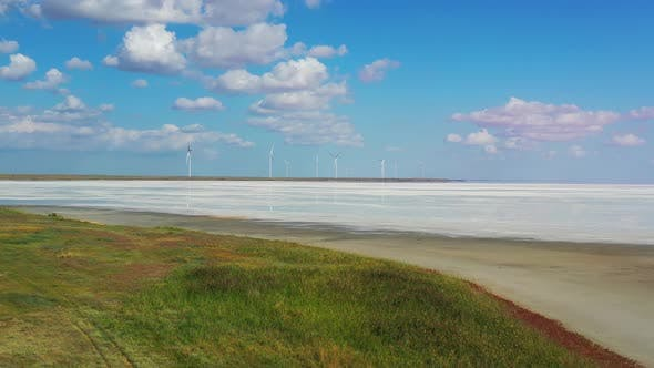 Thumbnail for Landscape View on the Wind Turbines in the Distance and White Sand
