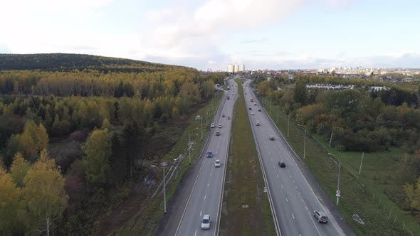 Thumbnail for Aerial shot autumn road with lots of cars