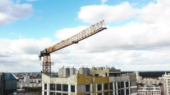 Thumbnail for Drone Flying Close Around Construction Crane During Development Process of High Rise Tower Block
