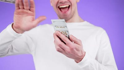 Young Man with Smile Scatters Cash Money