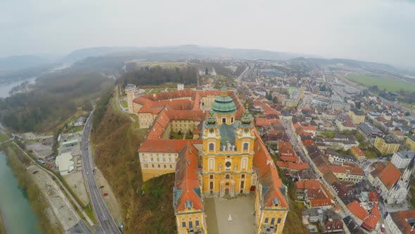 Thumbnail for Aerial Shot of Beautiful Melk Abbey in Austria. River Danube. Cold Rainy Weather