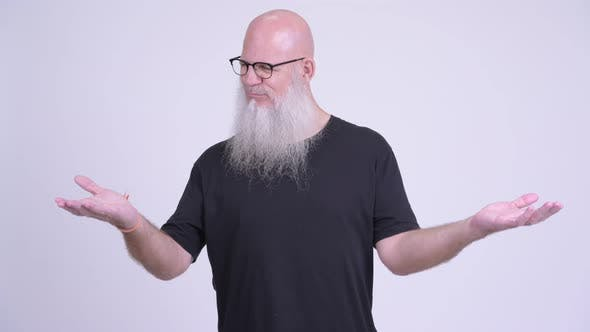 Thumbnail for Mature Bald Bearded Man Comparing Something
