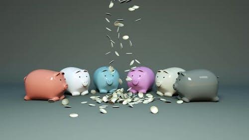 Coins fall next to piggy banks