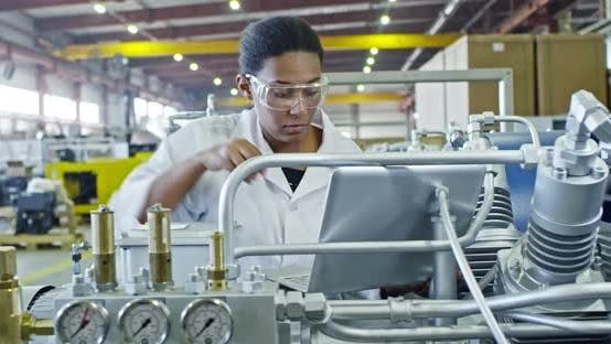 Cover Image for African Female Factory Engineer Using Laptop
